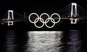 The Olympic Rings at Odaiba Marine Park, under the Rainbow Bridge and Tokyo Tower.