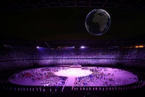 Drones form a shape of the world during the opening ceremony, seen above the Olympic Stadium.