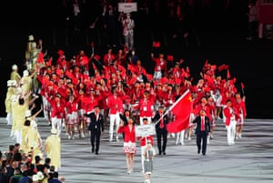 Olympic delegation of the People's Republic of China parade into the Olympic Stadium.