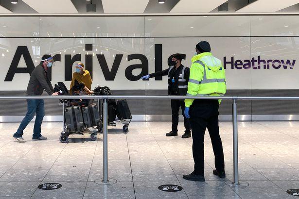 Passengers are escorted through the arrivals area