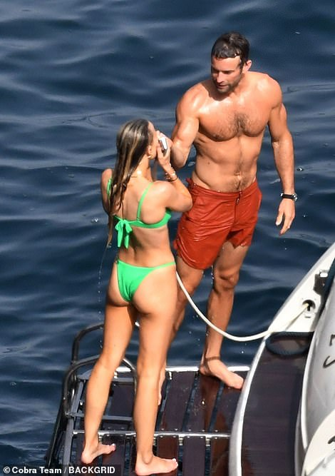 Holiday:Chace Crawford showed off his muscular physique as joined on-off girlfriend Rebecca Rittenhouse for a sun-soaked boat trip in Capri, Italy on Wednesday