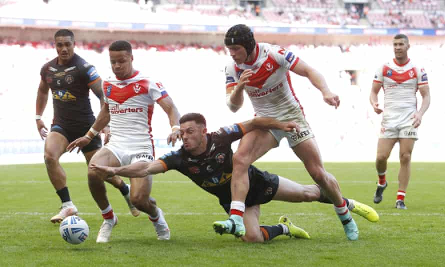 Castleford's Niall Evalds makes a timely intervention at Wembley.