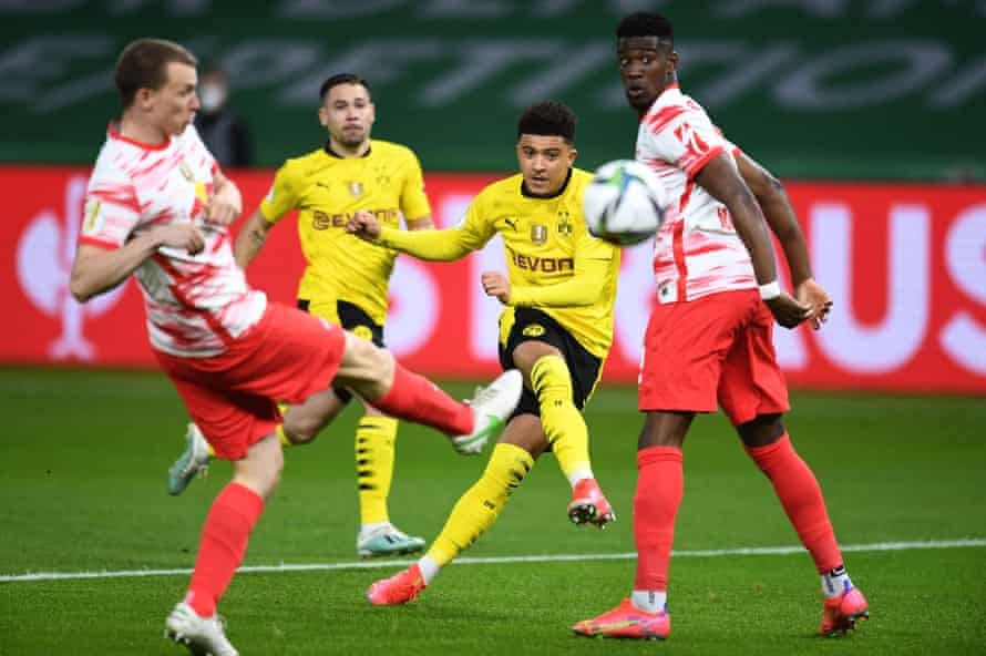 Jadon Sancho scores for Borussia Dortmund in the German Cup final win against RB Leipzig in May.