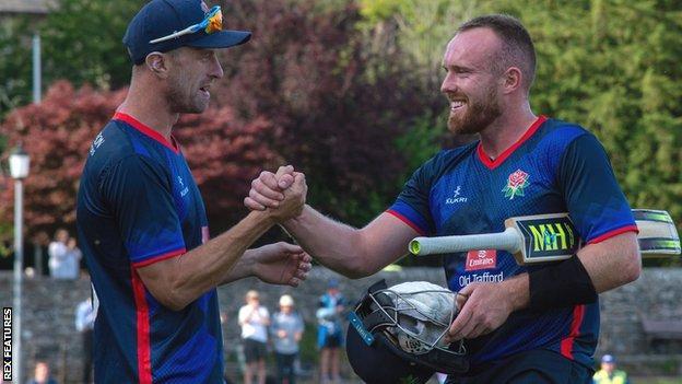 Danny Lamb (right) celebrates Lancashire's win over Sussex