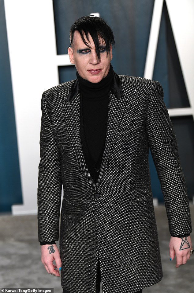 Booked and released: Marilyn Manson (above in 2020) turned himself in to the police last week for charges related to a 2019 incident where he allegedly spit and blew snot at a female videographer