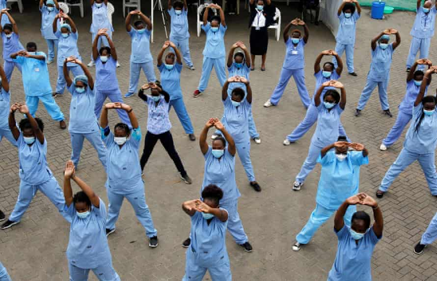 Nurses in scrubs do fitness class
