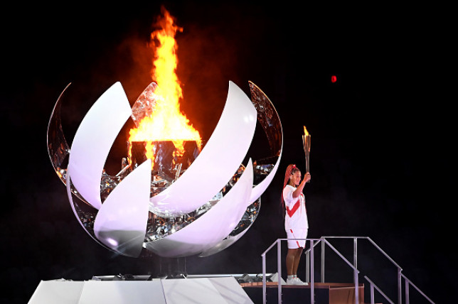 Tennis star Naomi Osaka lit the Olympic cauldron at the Tokyo 2020 opening ceremony