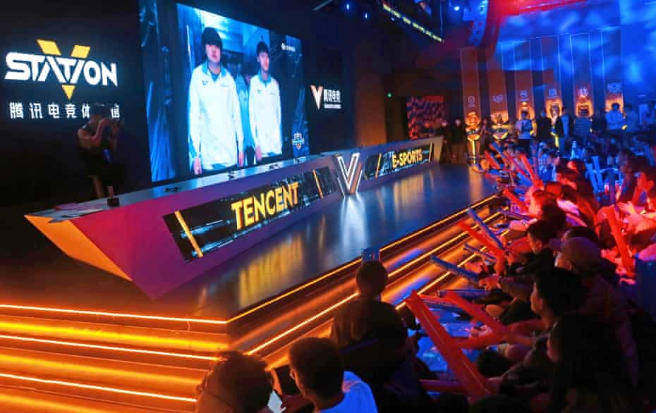 Esports fans at the Tencent V-Station watch the live broadcast of the League of Legends S10 finals in Shanghai in October 2020.