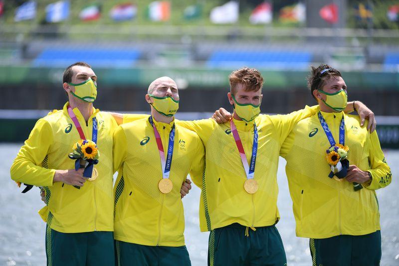 Olympics-Rowing-Britain's golden run in men's four ends, Australia triumphs
