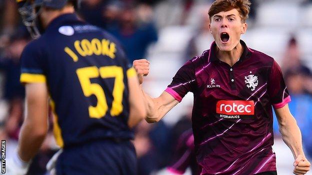 Somerset's Kasey Aldridge celebrates the wicket of Glamorgan's Joe Cooke