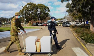 NSW In Lockdown As Covid-19 Community Cases Continue To EmergeSYDNEY, AUSTRALIA - AUGUST 02: Australian Defence Force personnel and NSW police load food packages for delivery to people in lockdown at the Prairiewood Leisure Centre on August 02, 2021 in Sydney, Australia. Hundreds of Australian Defence Force personnel will assist the police to ensure residents in hot spots to ensure close contacts are isolating at home and to enforce health orders restricting movement and requiring masks outdoors and to ensure close contacts are isolating at home. Greater Sydney is in lockdown through August 28th to contain the highly contagious Covid-19 delta variant. (Photo by Lisa Maree Williams/Getty Images)