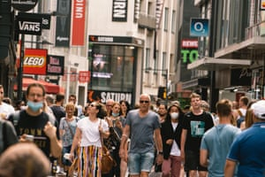 Shoppers in Cologne city centre in July