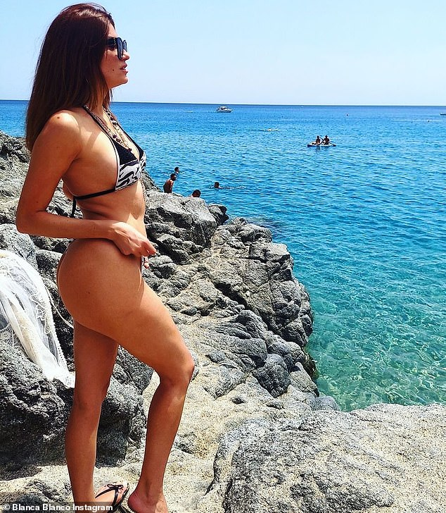 Showing off every curve: Blanco flaunts her pert posterior while staring out, over the water at the horizon