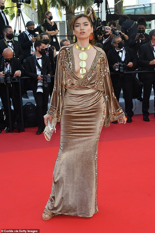 Dramatic:The Mission: Possible actress wore a plunging deep beige gown with a long yellow gold necklace