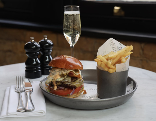 Burger, fries and a glass of champange at The Saxon