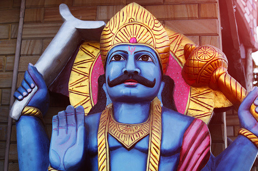 A statue for the Hindu god Shani in a temple.