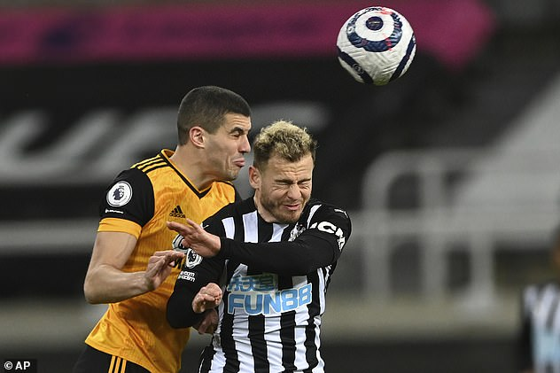 Professional footballers who play in defence are five times more likely to develop dementia than midfielders, strikers and goalkeepers, new research has found. Pictured: Conor Coady (left) and Ryan Fraser (right), jumping for a header