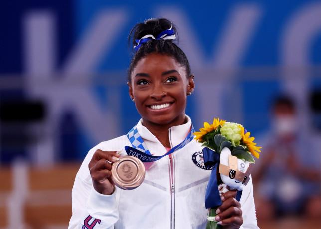 Tokyo 2020 Olympics - Gymnastics - Artistic - Women's Beam - Medal Ceremony - Ariake Gymnastics Centre, Tokyo, Japan - August 3, 2021. Bronze medallist Simone Biles of the United States celebrates on the podium REUTERS/Mike Blake