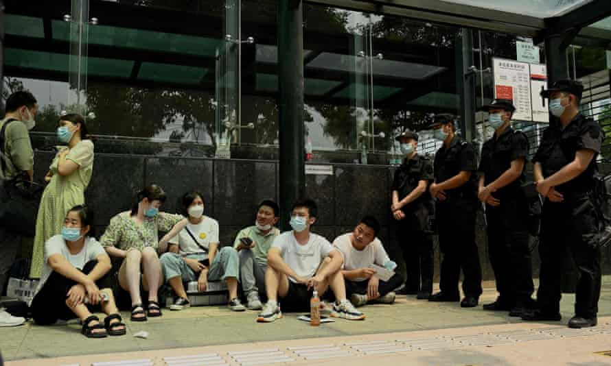 Protesters at the Evergrande headquarters building in Shenzhen, south-east China.