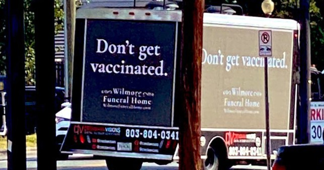 A van with the advert 'Don't get vaccinated'