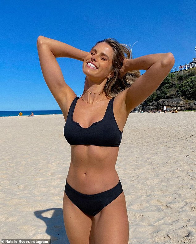 Happy to be back:The 31-year-old was beaming ear-to-ear as she skipped along Tamarama beach in a chic black swimsuit