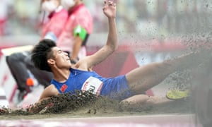 Zhu Dening of China competes during the men's T38 class long jump final.