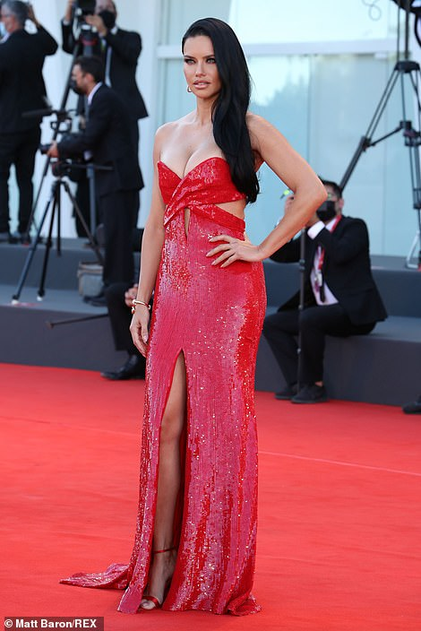 Wow! The floor-length gown - which featured sultry cut out sections across the midriff - was completely covered in dazzling red sequins and featured a thigh-high slit up the leg