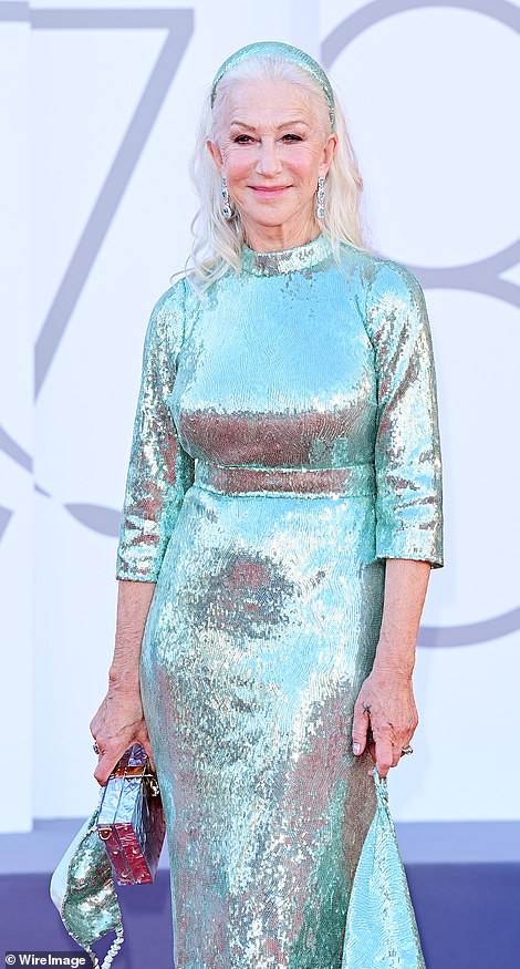 Angelic: Dame Helen, 76, belied her age in the cinched, form-fitting dress while posing for photographers at the star-studded event