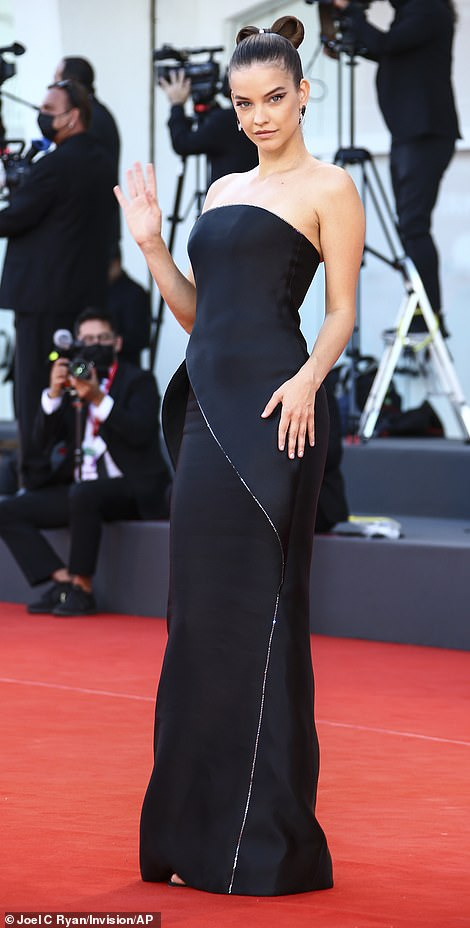 Strike a pose! Barbara Palvin cut a cool figure in an egdy black dress with structured detailing