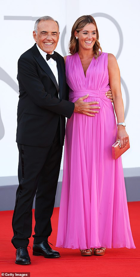 Aw! Director of the Festival Alberto Barbera affectionately held his pregnant wife Julia Barbera as they arrived together