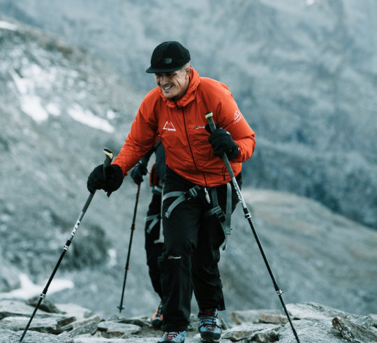 Ed climbing steep mountain