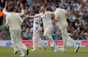 Ollie Robinson celebrates getting the wicket of Virat Kohli.