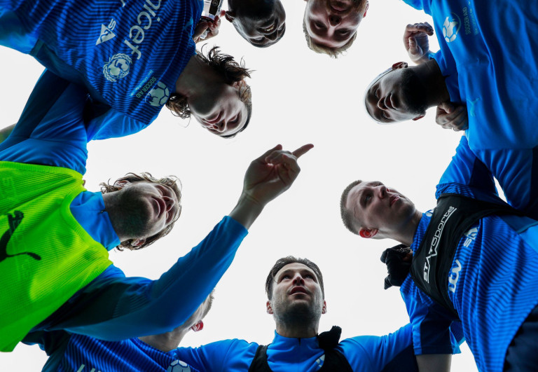 England players huddle during a training session Soccer Aid for