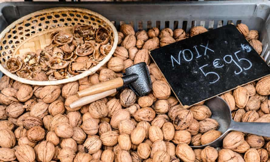 Walnuts and walnut cracker for sale at farmers market in France