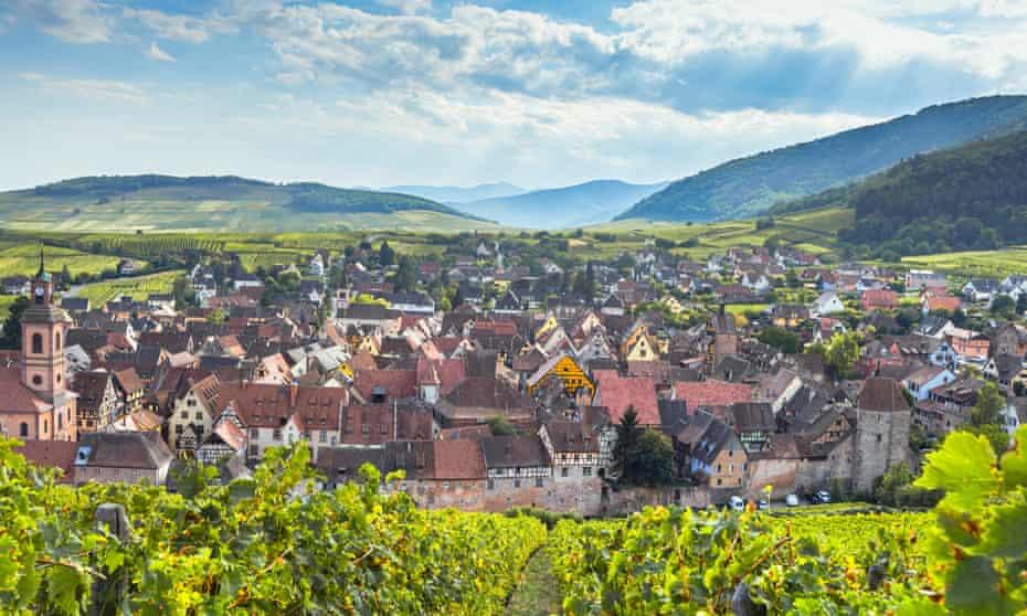 Wine village Riquewihr and the Vosges mountains.