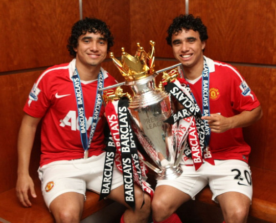 Rafael Da Silva  and Fabio Da Silva of Manchester United pose in the dressing room with the Barclays Premier League trophy back in 2011