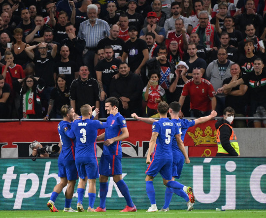 England's football team celebrates the 0-3 during the FIFA World Cup Qatar 2022 qualification Group I football match between Hungary and England, at the Puskas Arena in Budapest on September 2, 2021.