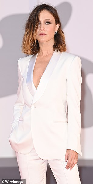 Incredible: Also taking to the red carpet was Gabriella Pession who set pulses racing in nothing but a plunging snow white blazer and trousers