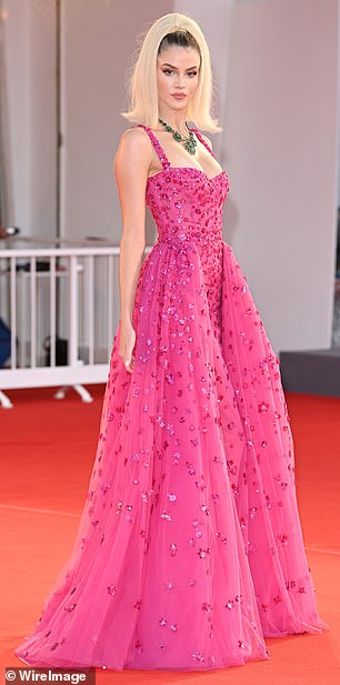 Unmissable: Sara Croce looked heavenly in a hot pink princess dress, which featured purple embellishments