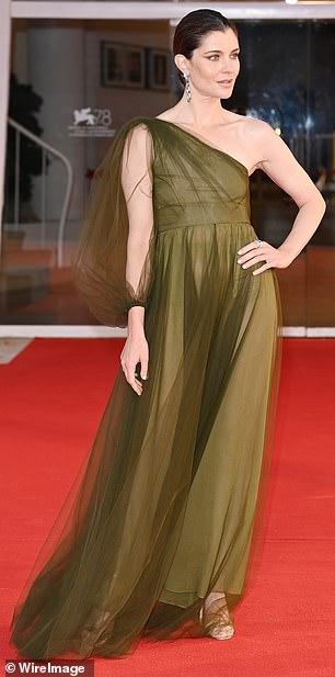 Elegant: Vittoria Puccini rocked an asymmetrical dark green maxi dress, which showed off her toned waist