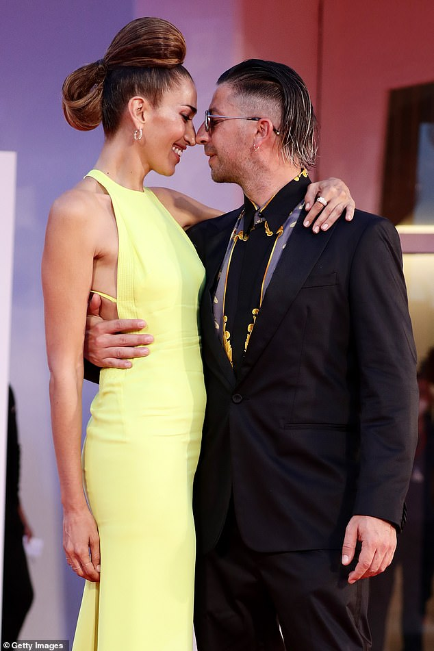 In love: Nina Zilli, who stunned in a lime green gown, and Daniele Lazzarin, who accented a gold-printed shirt with a classic black suit, showed their affection as they rubbed noses