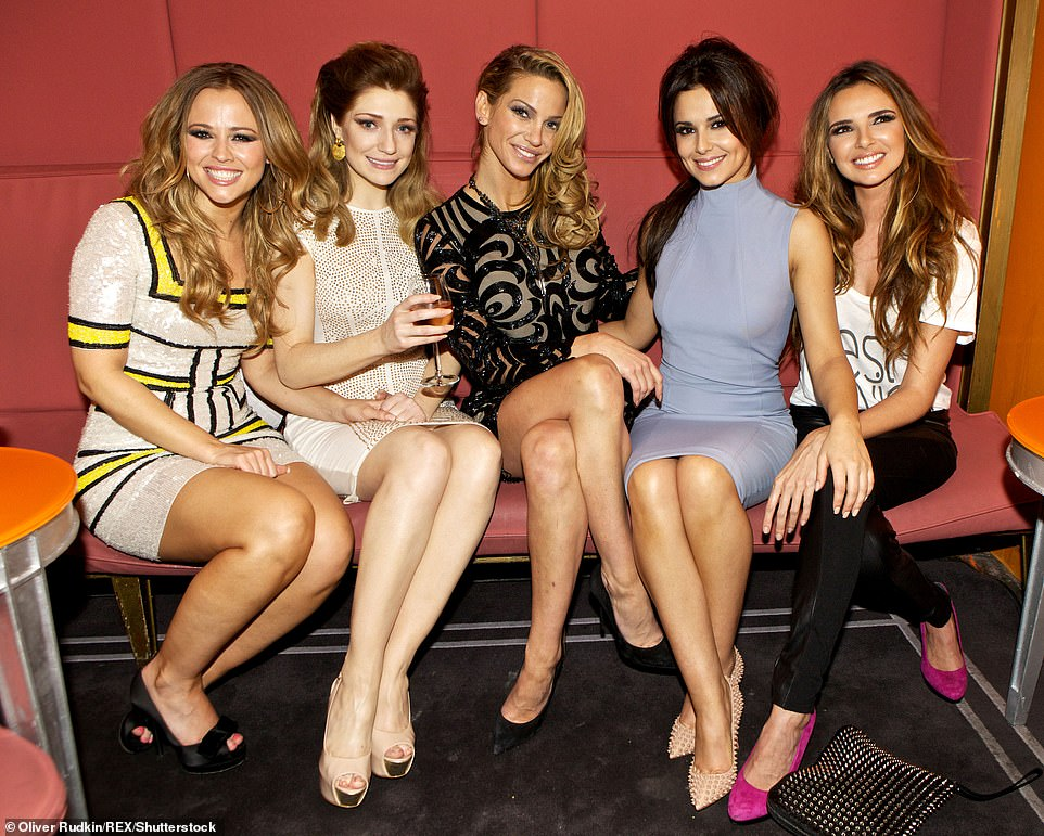 Iconic band: Girls Aloud stars Nicola Roberts (second left) and Nadine Coyle (end right) paid tribute on social media (pictured 2012 with the band including Cheryl, Sarah and Kimberley Walsh)