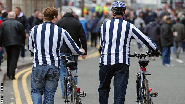 Fans cycling to match