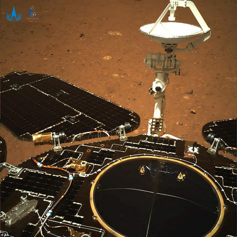 In this CNSA photo taken by China's Zhurong Mars rover and dated May 19, a rear view of the rover shows solar panels and antenna are deployed as the rover sits on its lander on the surface of Mars
