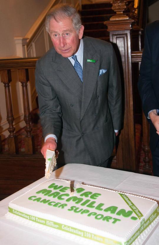 prince charles cuts a macmillan cake