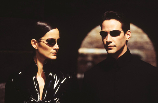 Editorial use only. No book cover usage. Mandatory Credit: Photo by Warner Bros/Village Roadshow Pictures/Kobal/REX (5885917i) Carrie-Anne Moss, Keanu Reeves The Matrix Reloaded - 2003 Director: Andy & Larry Wachowski Warner Bros/Village Roadshow Pictures USA Scene Still Scifi