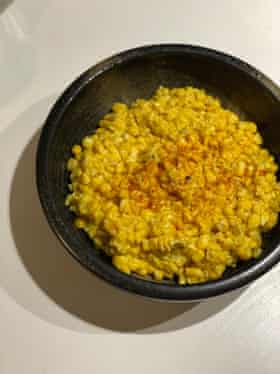 Cook's Illustrated's creamed corn uses shallots and thyme to accentuate.