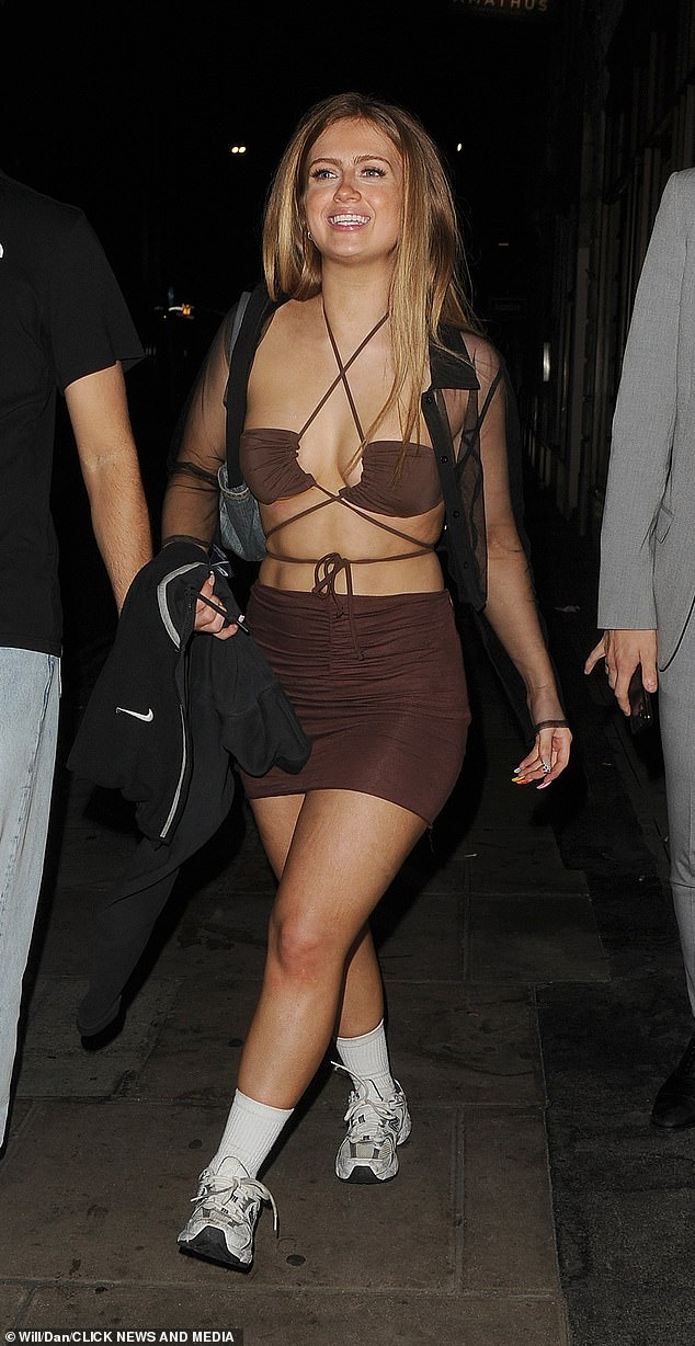 Revealing:The former Strictly Come Dancing star, 20, left little to the imagination in her daring outfit as she strolled through Soho and headed to G-A-Y Bar
