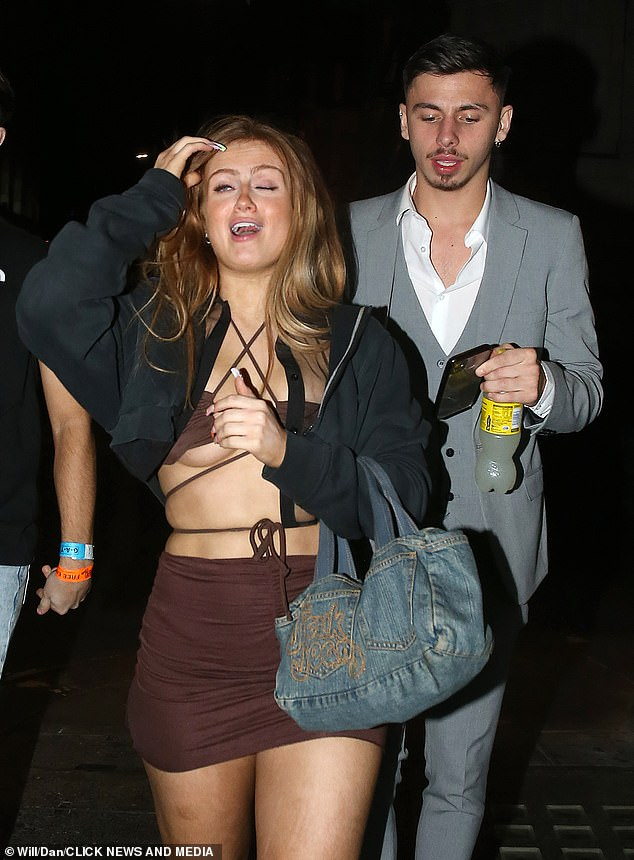 New man?Maisie was seen chatting to a gentleman in a grey suit