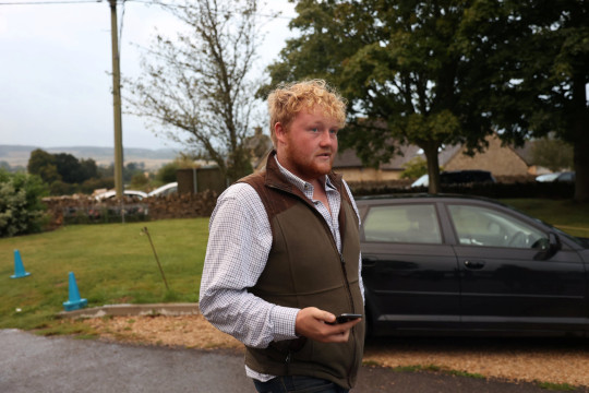 Kaleb Cooper arrives at the town hall meeting called to discuss the farm shop,